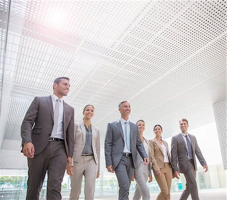 Business people walking Stock Photo - Premium Royalty-Free, Code: 6113-07588926