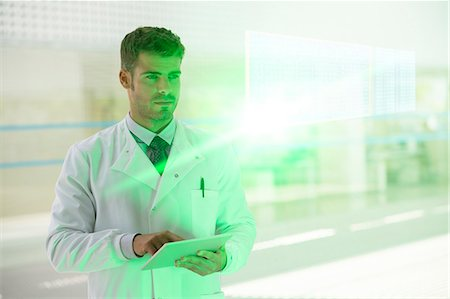 Serious doctor with digital tablet in hospital Stock Photo - Premium Royalty-Free, Code: 6113-07589059
