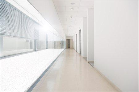 Long empty corridor Stock Photo - Premium Royalty-Free, Code: 6113-07589078