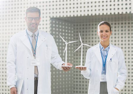 female - Portrait of scientists holding wind turbine models Stock Photo - Premium Royalty-Free, Code: 6113-07589025