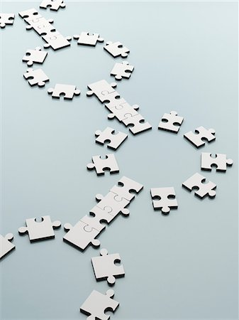 Connecting jigsaw pieces Stock Photo - Premium Royalty-Free, Code: 6113-07589120