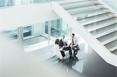 Doctor and administrators talking in hospital lobby Stock Photo - Premium Royalty-Free, Code: 6113-07589245