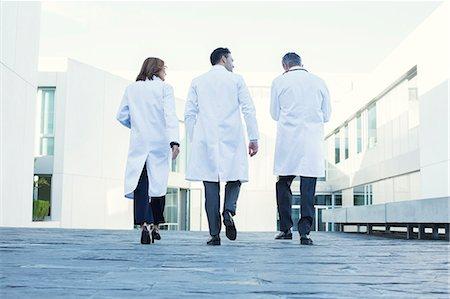 Doctors walking on rooftop Stock Photo - Premium Royalty-Free, Code: 6113-07589257