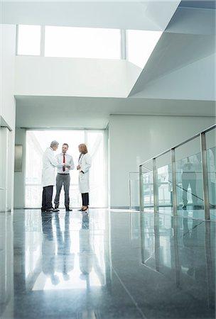 people hospital - Doctors and administrators talking in hospital corridor Stock Photo - Premium Royalty-Free, Code: 6113-07589273