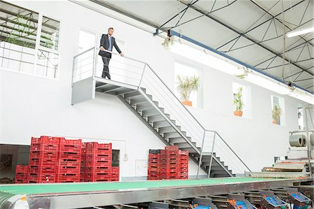 people working in factory - Supervisor standing on platform in food processing plant Stock Photo - Premium Royalty-Free, Code: 6113-07589271