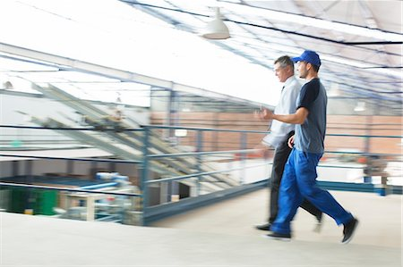 food processing plant - Supervisor and worker walking in food processing plant Stock Photo - Premium Royalty-Free, Code: 6113-07589272