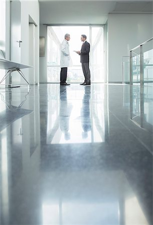 people hospital - Doctor and administrator talking in hospital corridor Stock Photo - Premium Royalty-Free, Code: 6113-07589276