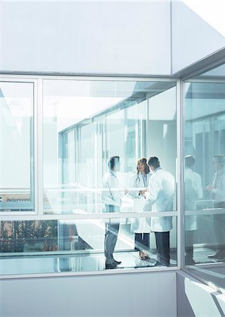 Doctors and administrator in office corridor Stock Photo - Premium Royalty-Free, Code: 6113-07589288