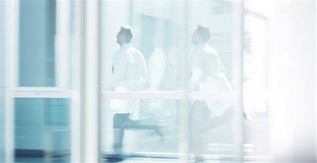 people hospital - Doctors running in hospital corridor Stock Photo - Premium Royalty-Free, Code: 6113-07589294