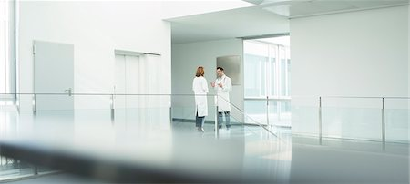 people hospital - Doctors talking in hospital corridor Stock Photo - Premium Royalty-Free, Code: 6113-07589296