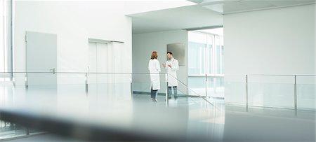 Doctors talking in hospital corridor Stock Photo - Premium Royalty-Free, Code: 6113-07589296