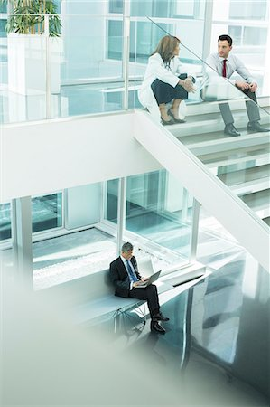 people hospital - Doctor and administrator talking on hospital stairs Stock Photo - Premium Royalty-Free, Code: 6113-07589233