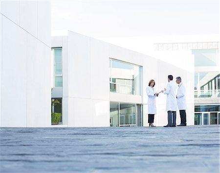 people hospital - Doctors talking on rooftop Stock Photo - Premium Royalty-Free, Code: 6113-07589232