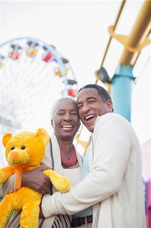 Portrait of smiling senior couple at amusement park Stock Photo - Premium Royalty-Free, Code: 6113-07589351