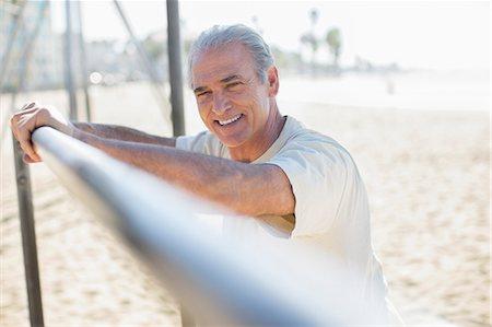 exterior bar - Portrait of senior man leaning on bar at beach Stock Photo - Premium Royalty-Free, Code: 6113-07589367
