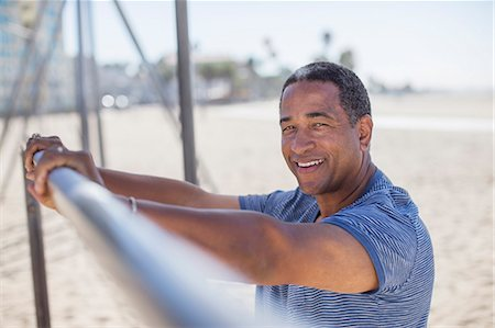 exterior bar - Portrait of senior man leaning on bar at beach playground Stock Photo - Premium Royalty-Free, Code: 6113-07589369