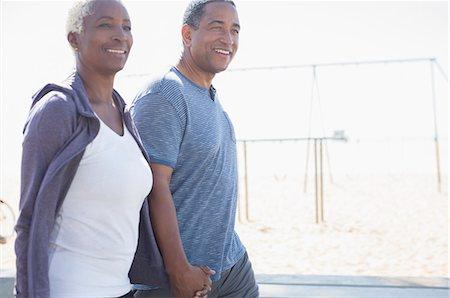 Senior couple holding hands and walking Stock Photo - Premium Royalty-Free, Code: 6113-07589374