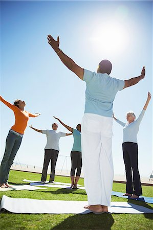 Seniors practicing yoga in sunny park Stock Photo - Premium Royalty-Free, Code: 6113-07589392