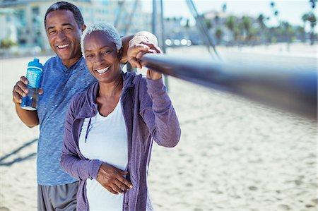 exterior bar - Portrait of smiling senior couple on beach playground Stock Photo - Premium Royalty-Free, Code: 6113-07589394