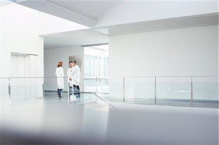 Doctors talking in hospital corridor Stock Photo - Premium Royalty-Free, Code: 6113-07589301