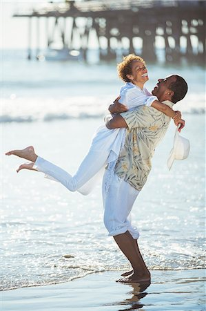Couple hugging on beach Stock Photo - Premium Royalty-Free, Code: 6113-07589333
