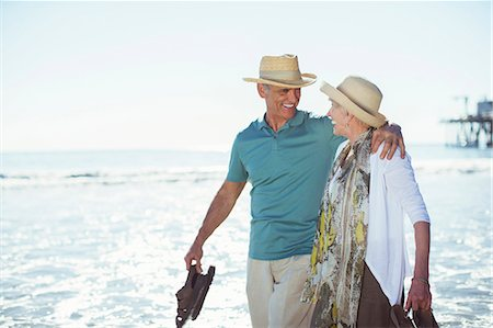senior women - Senior couple walking on beach Stock Photo - Premium Royalty-Free, Code: 6113-07589330