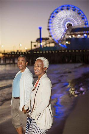 Senior couple walking on beach at sunset Stock Photo - Premium Royalty-Free, Code: 6113-07589447