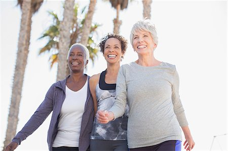 senior women - Senior women walking outdoors Stock Photo - Premium Royalty-Free, Code: 6113-07589453