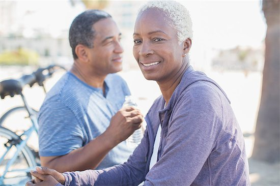 Portrait of smiling couple outdoors Stock Photo - Premium Royalty-Free, Image code: 6113-07589456