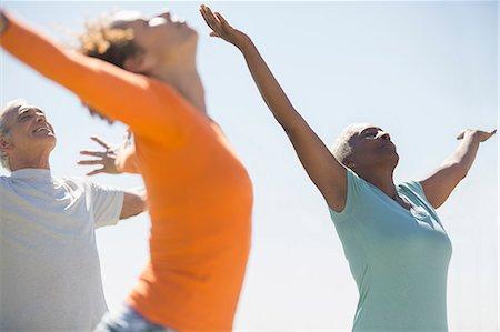 Seniors practicing yoga outdoors Stock Photo - Premium Royalty-Free, Code: 6113-07589460