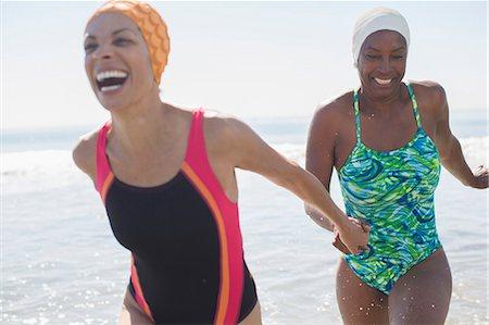 Enthusiastic lesbian couple at beach Stock Photo - Premium Royalty-Free, Code: 6113-07589470