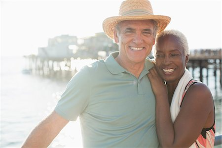 Portrait of happy senior couple on beach Stock Photo - Premium Royalty-Free, Code: 6113-07589471