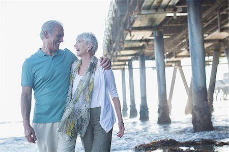 senior women - Senior couple laughing near pier at beach Stock Photo - Premium Royalty-Free, Code: 6113-07589478