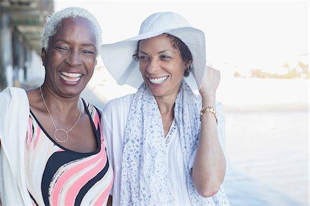 Portrait of smiling women at beach Stock Photo - Premium Royalty-Free, Code: 6113-07589479