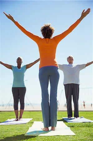 Seniors practicing yoga in sunny park Stock Photo - Premium Royalty-Free, Code: 6113-07589491