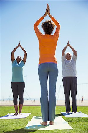 Yoga class in sunny park Stock Photo - Premium Royalty-Free, Code: 6113-07589497