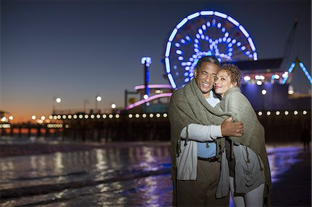 Couple hugging on beach at night Stock Photo - Premium Royalty-Free, Code: 6113-07589419