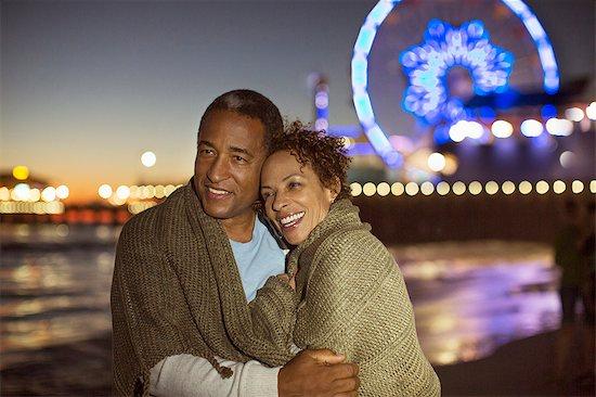 Couple hugging on beach at night Stock Photo - Premium Royalty-Free, Image code: 6113-07589424