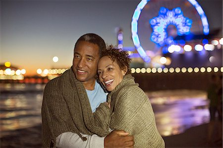Couple hugging on beach at night Stock Photo - Premium Royalty-Free, Code: 6113-07589424
