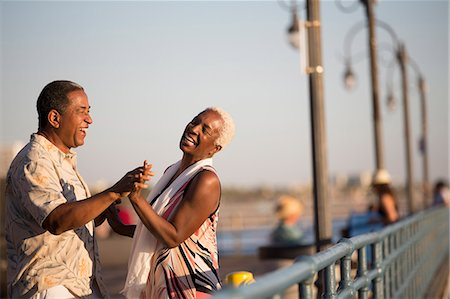 Senior couple dancing on pier Stock Photo - Premium Royalty-Free, Code: 6113-07589438