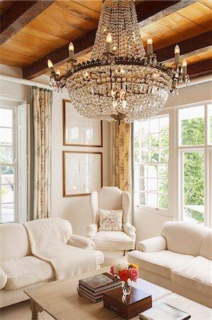 Luxury living room with chandelier Stock Photo - Premium Royalty-Free, Code: 6113-07589567