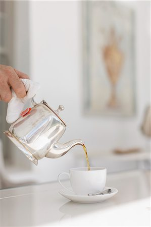 pouring - Hand pouring tea from silver teapot Stock Photo - Premium Royalty-Free, Code: 6113-07589606