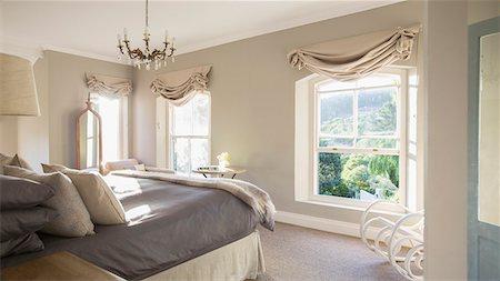 Sunny luxury bedroom Stock Photo - Premium Royalty-Free, Code: 6113-07589766