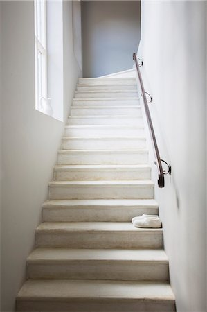 Slippers on whitewashed staircase Stock Photo - Premium Royalty-Free, Code: 6113-07589729