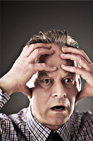 pressure - Close up of stressed businessman Stock Photo - Premium Royalty-Free, Code: 6113-07648693