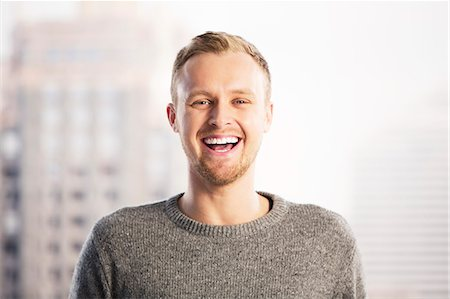 Portrait of laughing businessman Stock Photo - Premium Royalty-Free, Code: 6113-07648694