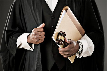 Close up of judge holding file and gavel Stock Photo - Premium Royalty-Free, Code: 6113-07648753