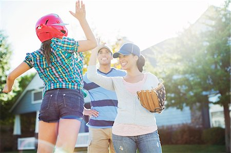 preteen family - Family playing baseball Stock Photo - Premium Royalty-Free, Code: 6113-07648763