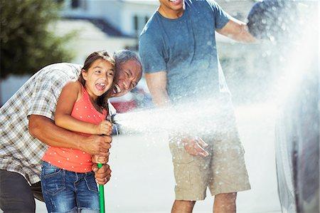 Multi-generation family washing car Stock Photo - Premium Royalty-Free, Code: 6113-07648764