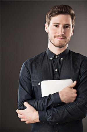 portrait - Portrait of serious businessman holding digital tablet Stock Photo - Premium Royalty-Free, Code: 6113-07648707